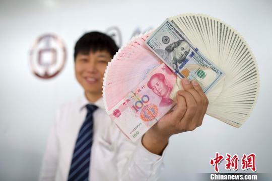 国家外汇局:6月中国外汇市场总计成交13.98万亿元
